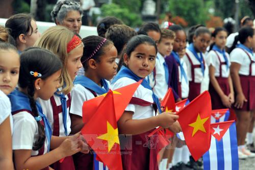 Hoạt động kỷ niệm 128 năm ngày sinh Chủ tịch Hồ Chí Minh của cộng đồng người Việt tại Lào và Cuba