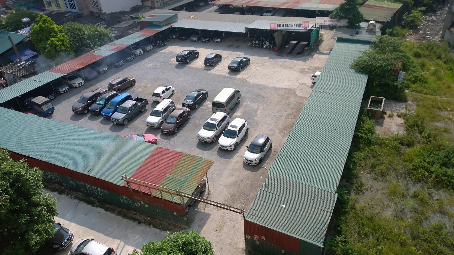 Quận Cầu Giấy (Hà Nội): Hàng loạt bãi xe không phép ngang nhiên hoạt động trên đất dự án?