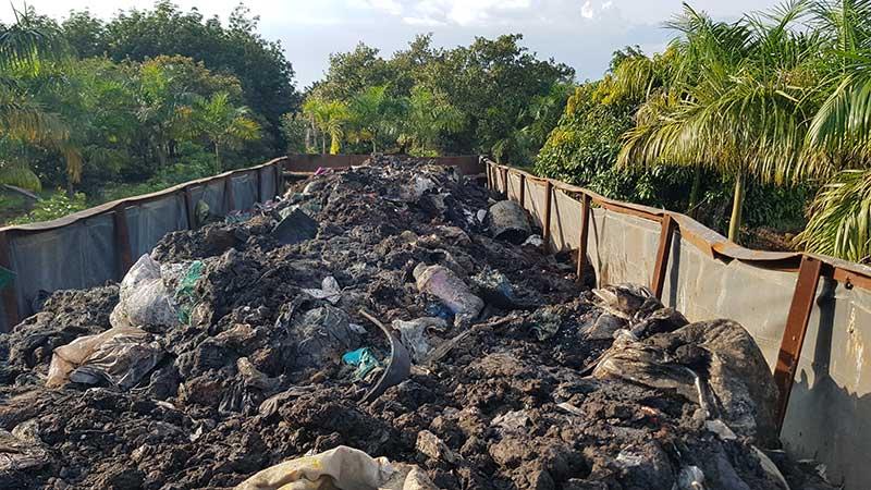 Bắt xe container đổ trộm hàng chục tấn chất thải rắn nguy hại