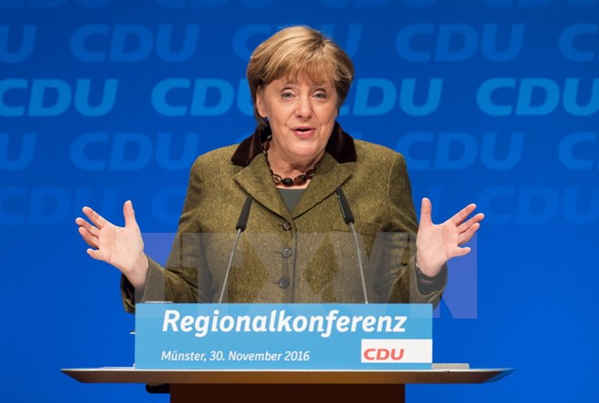 Angela Merkel wins re-election as Chair of CDU Party
