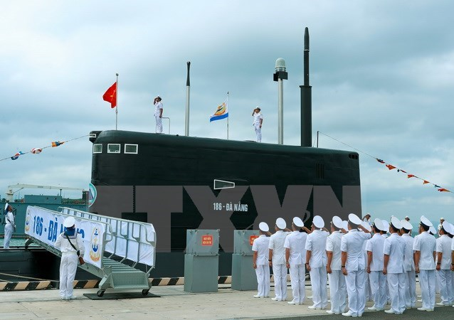 Flag-raising ceremony held for two new submarines