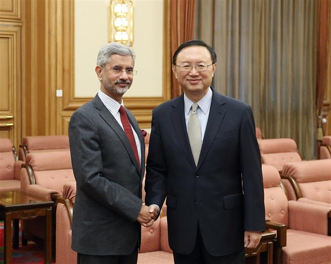 China, India pledge to promote bilateral relations
