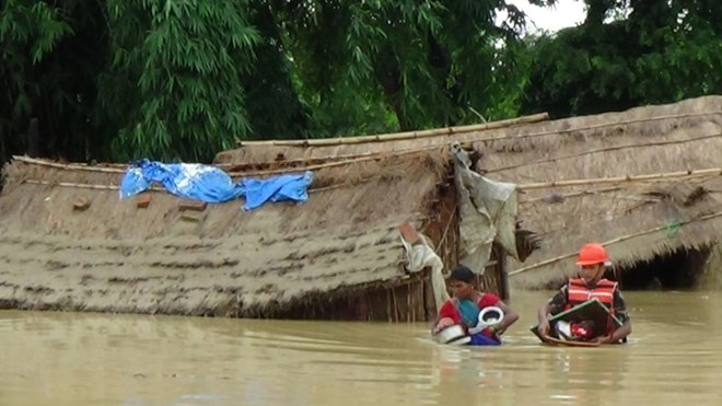 Flooding and landslides kill at least 90 in India and Nepal