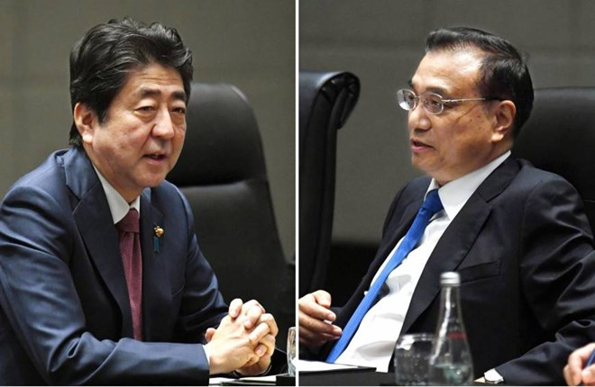 Japan, China pledge to promote bilateral ties