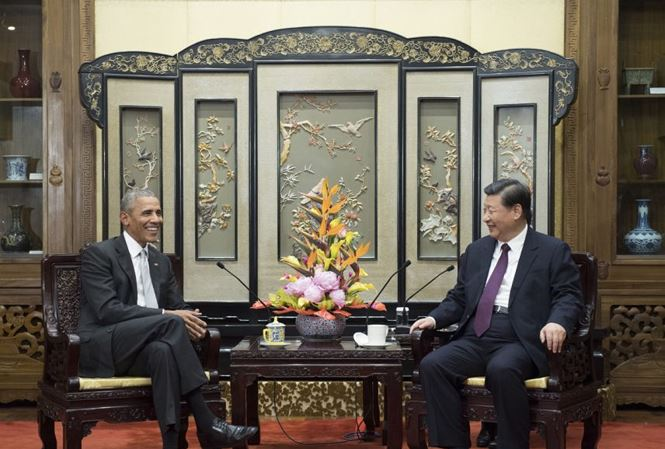 Chinese President Xi Jinping receives former US President Obama