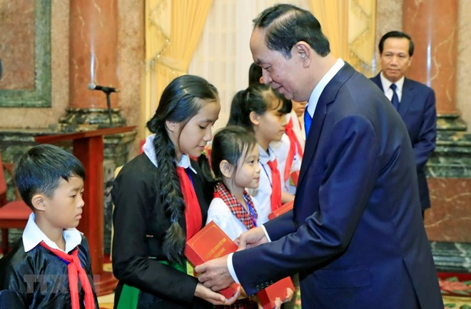 President commends disadvantaged students with high academic results