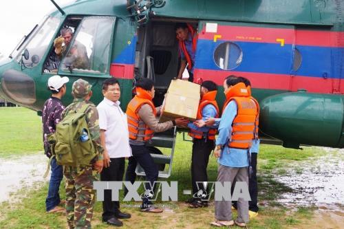 Vietnam army soldiers support Laos dam collapse recovery