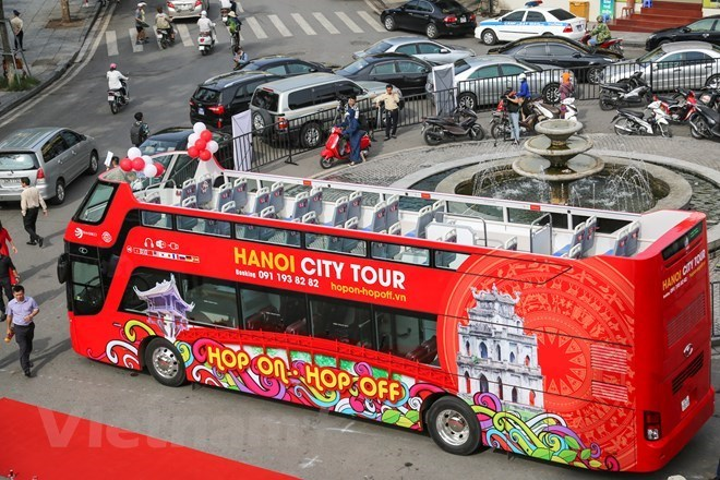 Hanoi's open top bus to run during evenings from August 1st