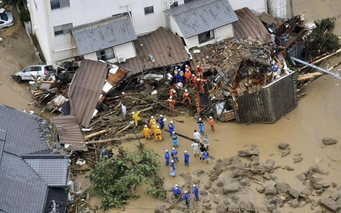 Flooding and landslides in Japan leave at least 100 dead