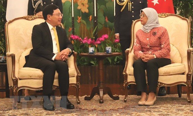 Deputy PM Pham Binh Minh meets Singaporean leaders