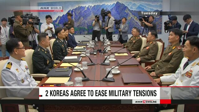 Two Koreas agree to ease military tensions