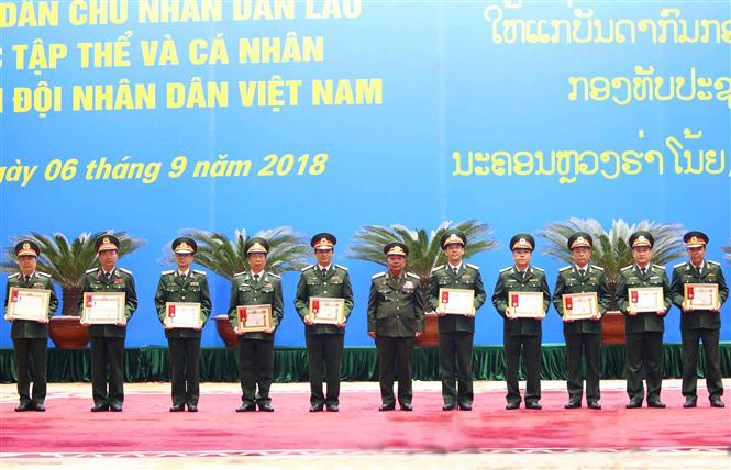 Vietnam People's Army officers presented with Lao medals