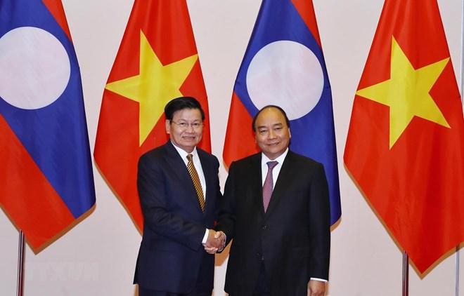 Vietnam, Laos resolved to create breakthrough in trade