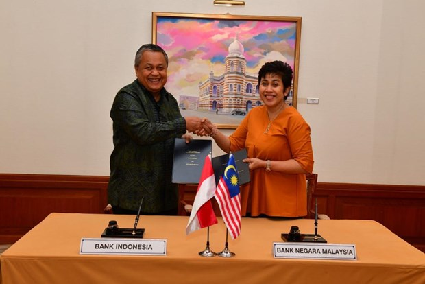 Malaysia, Indonesia sign USD-2-billion currency swap deal