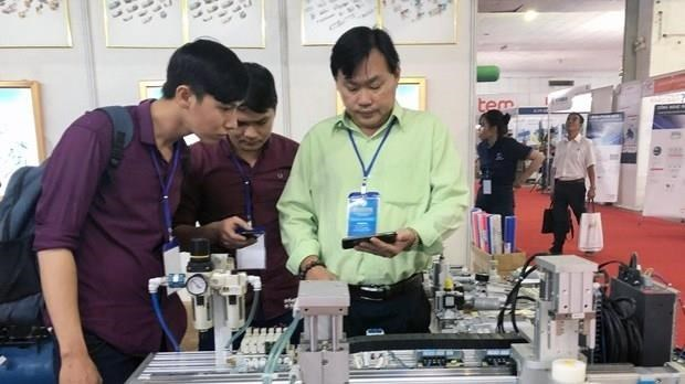 Electricity, printing industry exhibition chain opens in HCM city