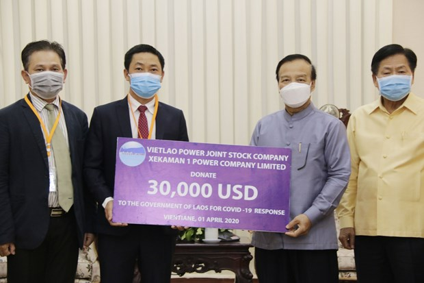 Vietnamese firm contributes to COVID-19 combat in Laos