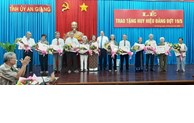 Awarding party badges in localities on occasion of May 19th