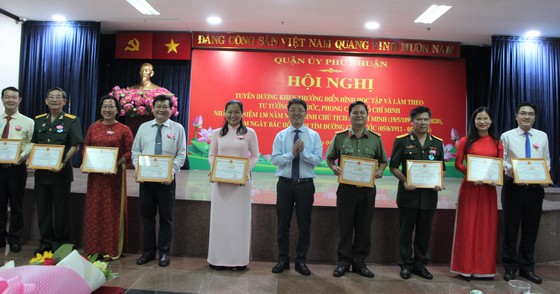 Ho Chi Minh city's district honours followers of Uncle Ho's example