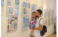 Photos on fight against COVID-19 pandemic on display