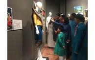 Admiring ASEAN traditional costumes in Hanoi