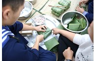 Island soldiers make sticky rice cakes for Tet