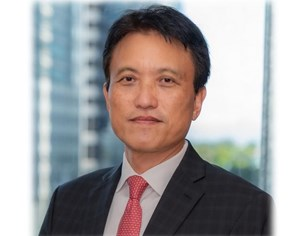ADB Appoints Woochong Um as Managing Director General