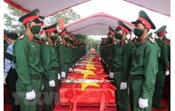 Remains of martyrs repatriated from Laos reburied in Nghe An, Thanh Hoa