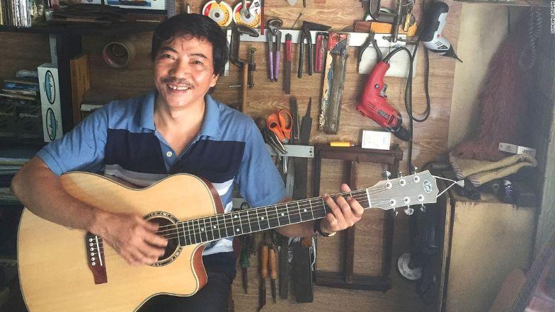 CNN présente la rue des guitares d'HCM-Ville