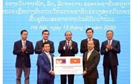 Remise symbolique de 1.000 tonnes de riz au Laos pour soutenir les sinistrés des intempéries