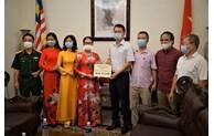 Des femmes vietnamiennes en Malaisie contribuent au Fonds de vaccins anti-COVID-19