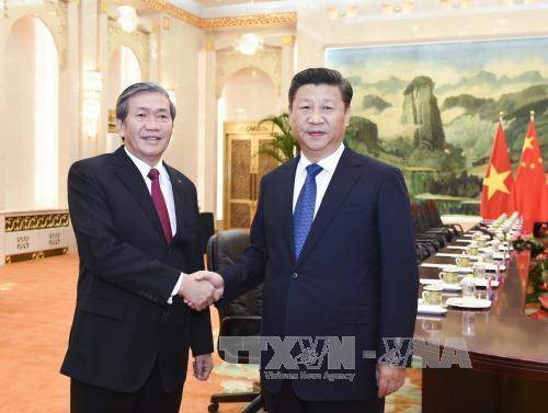 越共中央书记处常务书记丁世兄会见中共中央总书记、国家主席习近平