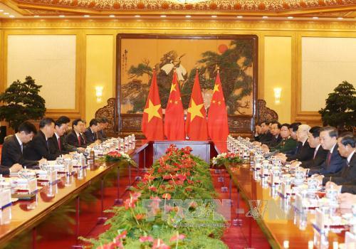 越共中央总书记阮富仲同中共中央总书记、中国国家主席习近平举行会谈