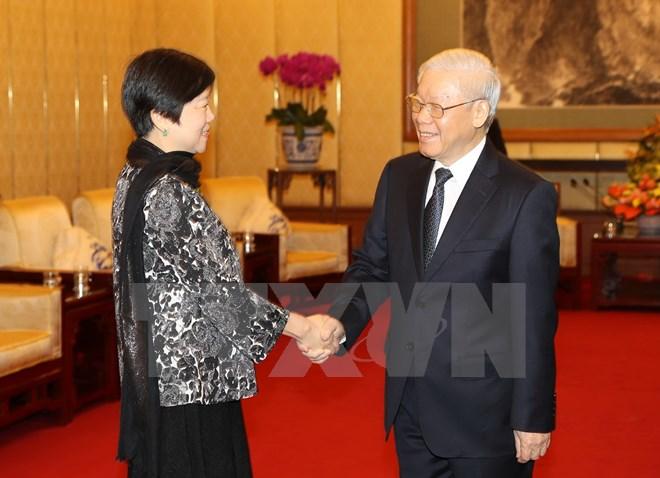 阮富仲总书记会见中国对外友协代表团并出席向李小林会长授予友谊勋章仪式