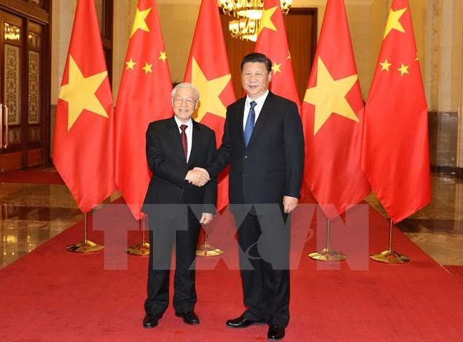 越中两党两国签署十五项合作文件