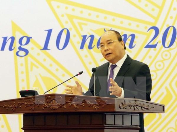 越南政府总理阮春福:对越南社会政策银行及贫困者的投资是以投入促发展的活动