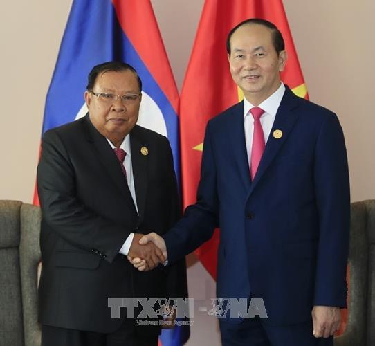 2017年APEC会议:越南国家主席陈大光会见老挝人革党中央总书记、国家主席本扬•沃拉吉