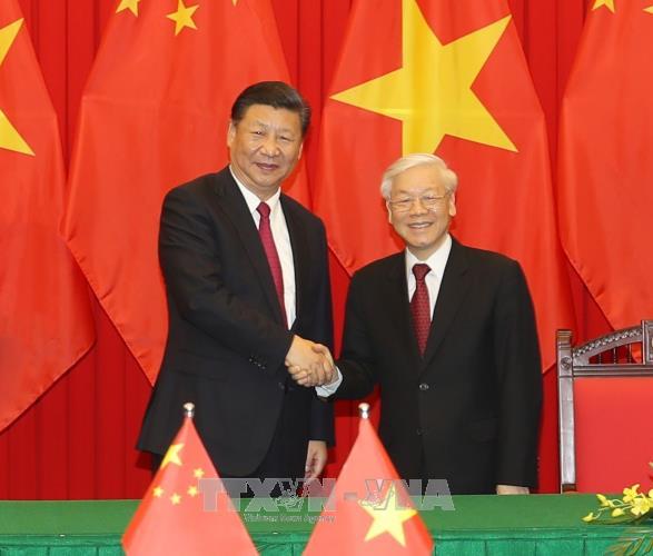 越中领导人互致新年贺信