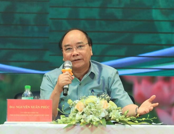 政府总理阮春福与农民对话