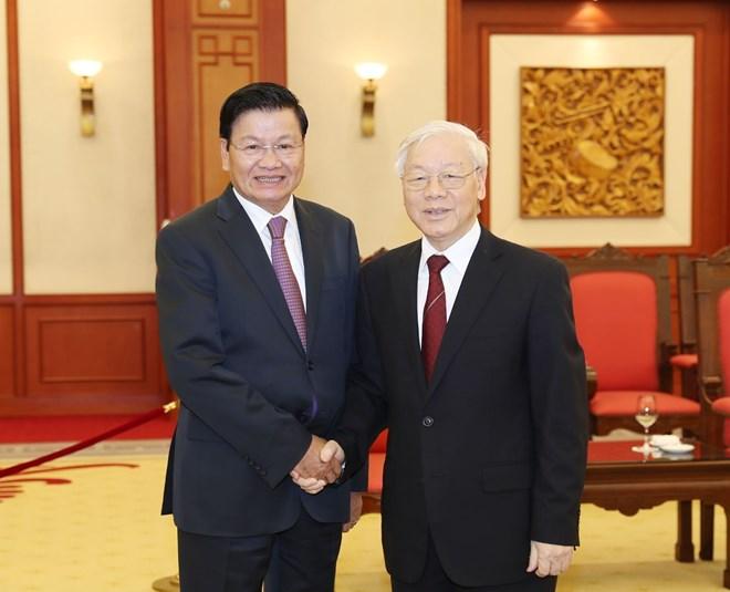 越南党和政府领导会见老挝人民民主共和国总理通伦•西苏里