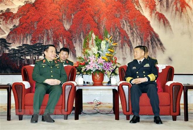 越南人民军总政治局与中共中央军委政治工作部加强合作