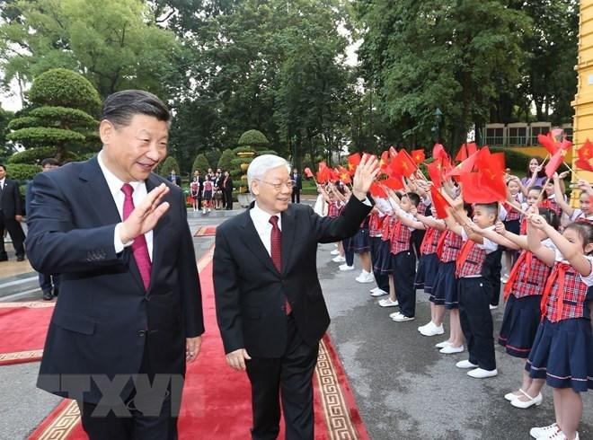 越中两国领导互致新年贺信
