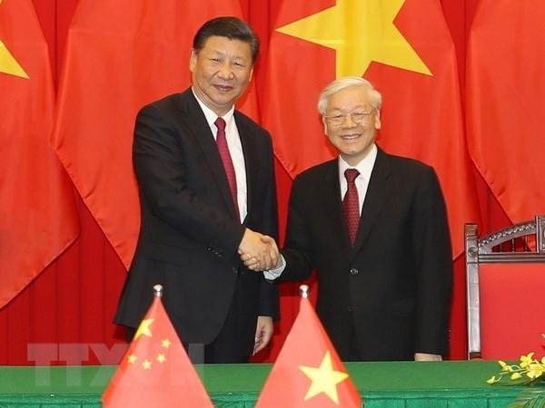 越中两国领导人互致建交69周年贺电