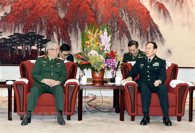 促进越南和中国军队交流合作