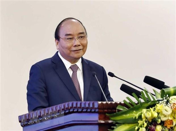 阮春福总理主持越老、越柬合作协议实施结果评估会议