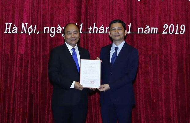 裴日光同志担任越南社会科学翰林院院长