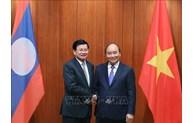 推动越南与老挝合作关系不断向前发展