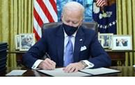美国新任总统拜登签署行政令宣布美国将重返《巴黎协定》