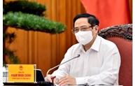 越南政府总理范明正就中期公共投资计划与各部委举行工作会议