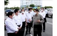越南政府总理范明正视察胡志明市新冠肺炎疫情防控工作