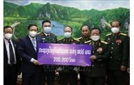 老挝国防部向越南新冠疫苗基金会捐赠20万美元善款
